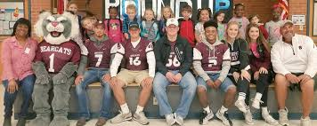 Sherman ISD Football team with students