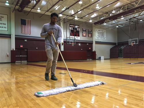 Keenon Briscoe cleaning the SHS gym