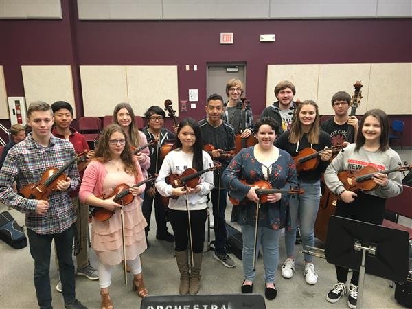 Orchestra students with instruments